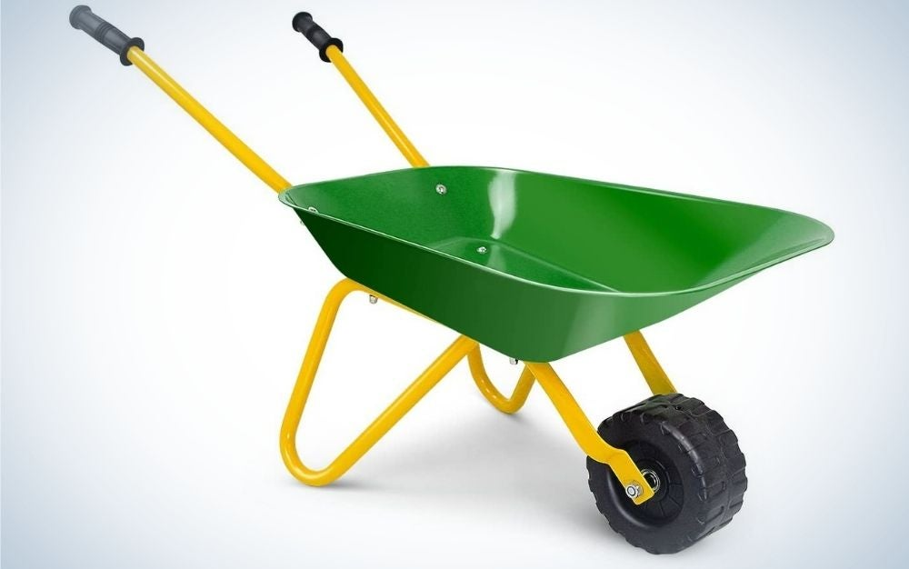 A small green wheelbarrow with a black wheel and a yellow structure.