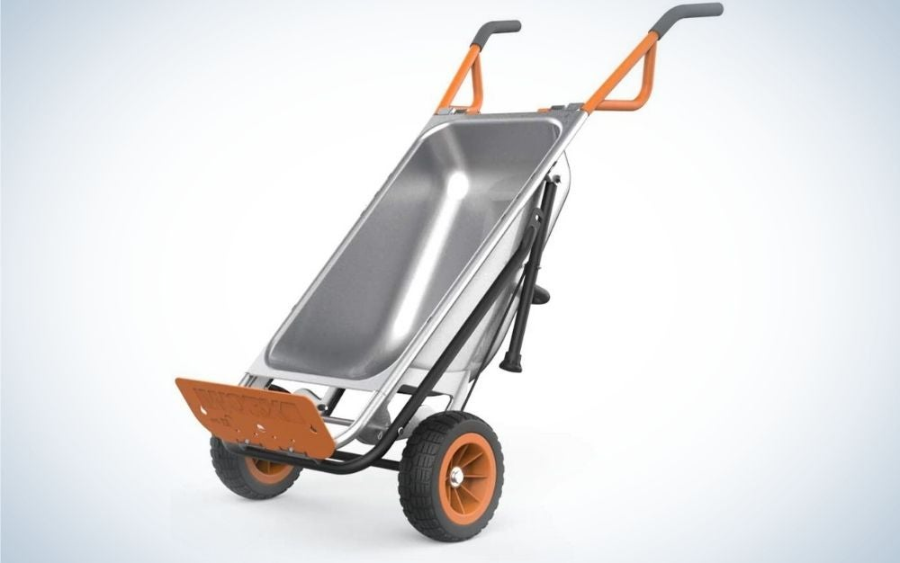 A small silver wheelbarrow with two black wheels and a silver structure and an orange support end at the bottom.