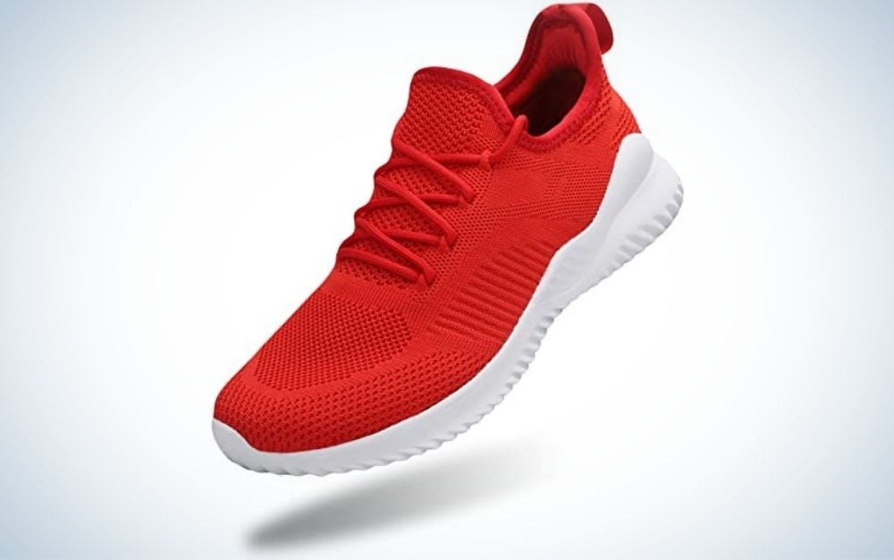 A sports sneaker with a white sole and a fiery red sneaker material.