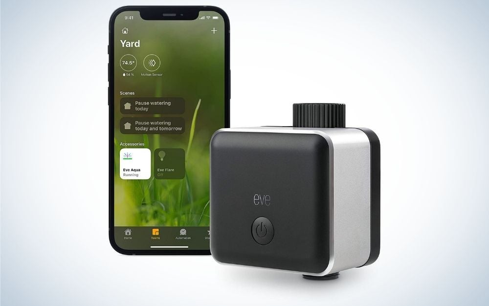 Black and gray smart sprinkler controller automated with apps on the phone