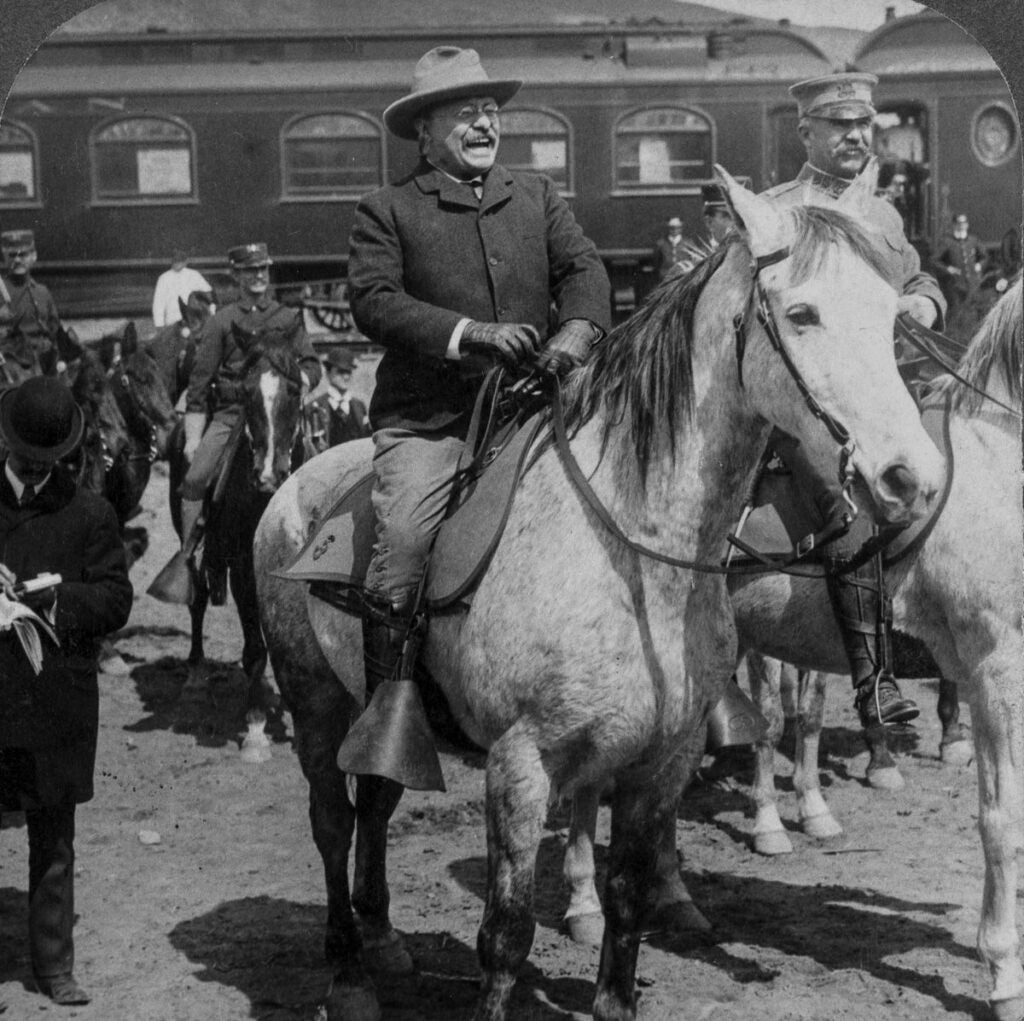 Teddy Roosevelt on a horse in Yellowstone National Park in black and white