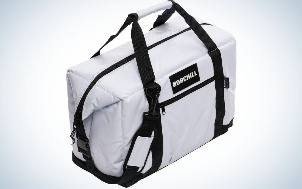 A rectangular shape black and white bag with the brand name into it and with a black zipper in the middle of the bag.