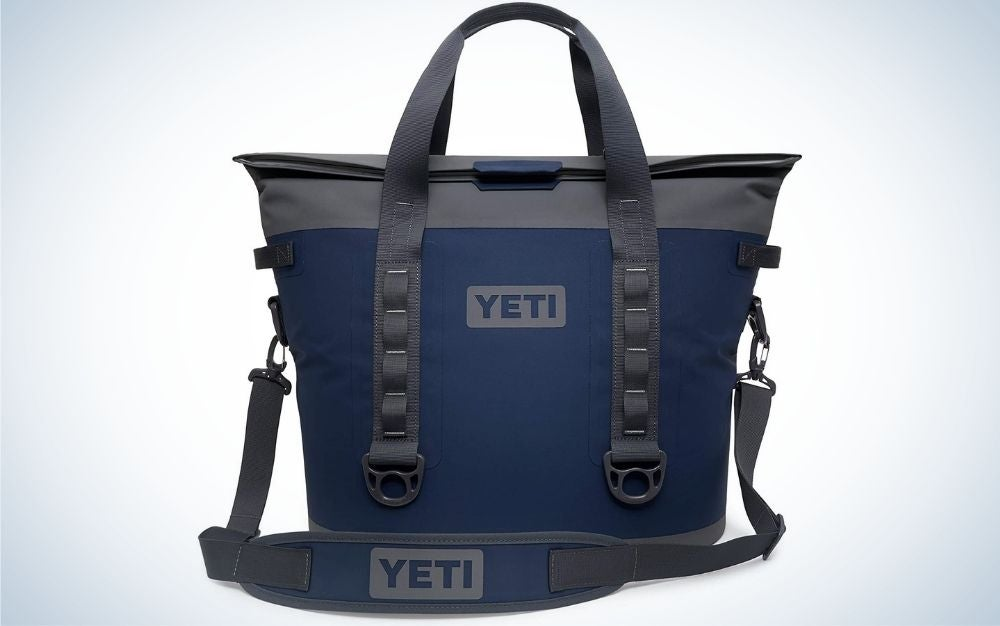 A square black and blue bag with two holding armrest and with brand name on it.