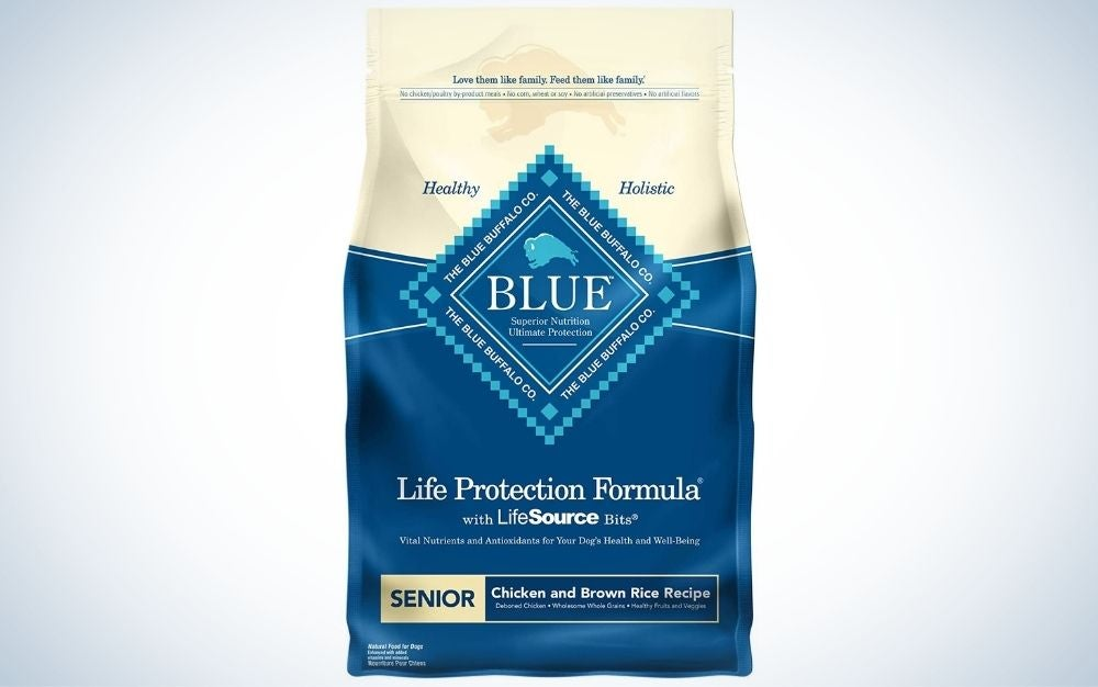 Chicken and brown rice flavored dry dog food on a blue and and light color package