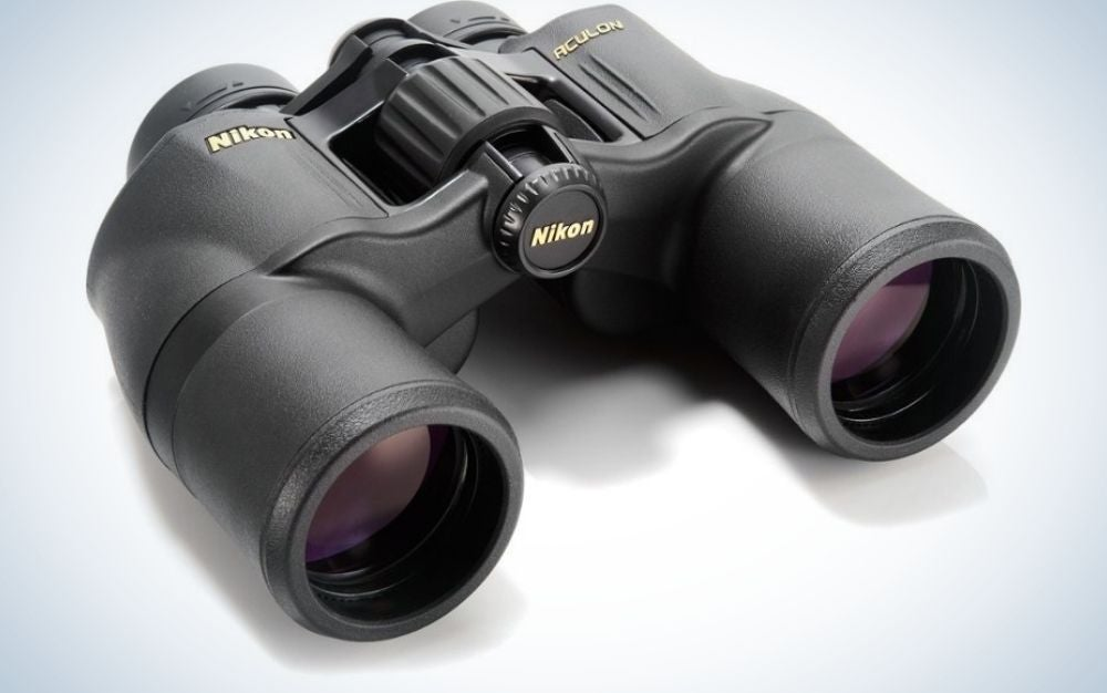 A pair of professional binoculars all black and with dark glass lenses and in large round shapes.