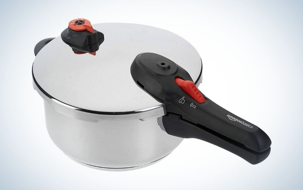 Stainless steel pressure cooker with black handle