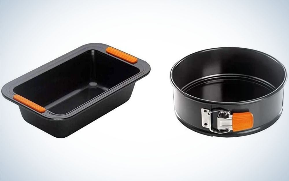 Two pans with different shapes where one is round and the other in a rectangular shape and both with black color and with orange clip.