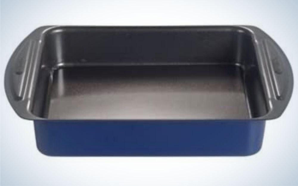 A large rectangular pan dark black and dark blue with two wide side pieces where it can be caught.