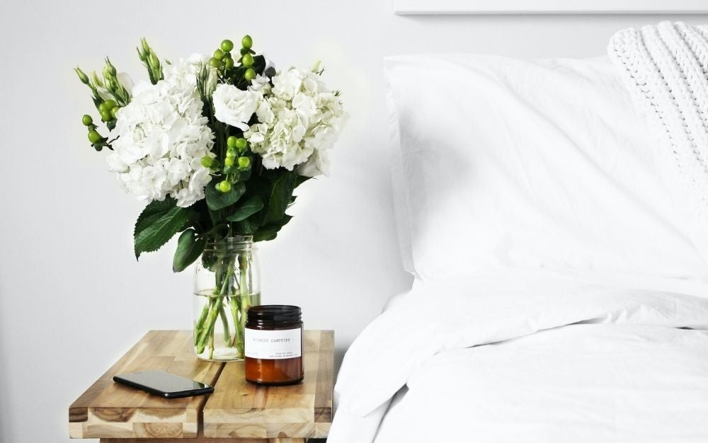 Photo of a bed with the best linen sheets.