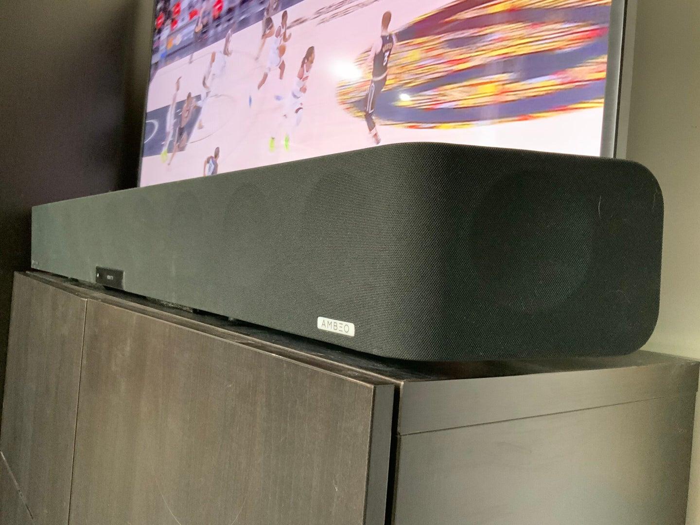 The Sennheiser AMBEO Soundbar in front of a flatscreen TV