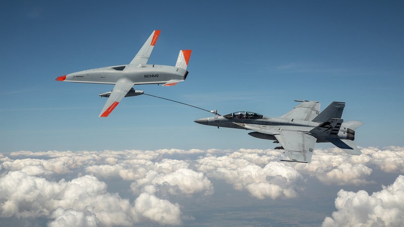 Watch a fighter jet and drone make 'wet contact' for the first time