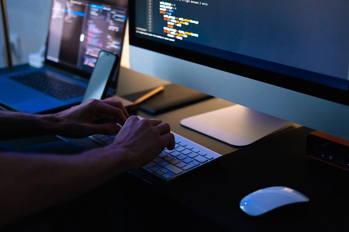 Person working on desktop computer.