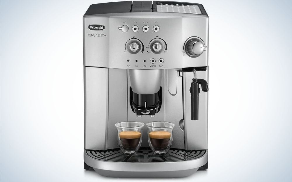 A coffee making machine which is all silver in color and with buttons on the top and two glass cups filled with coffee.