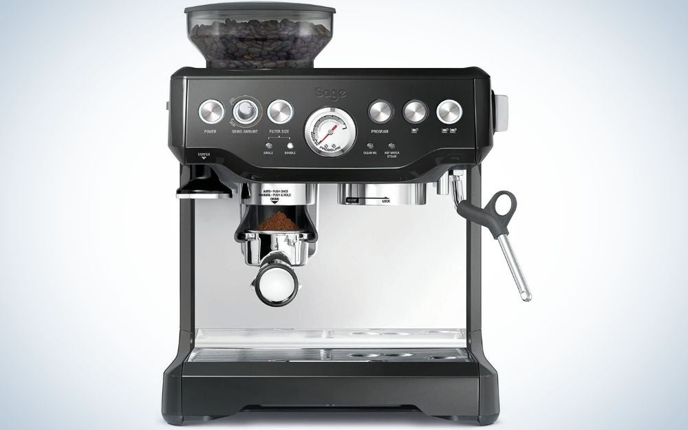 A coffee making machine which is all black and with the top full of silver buttons.
