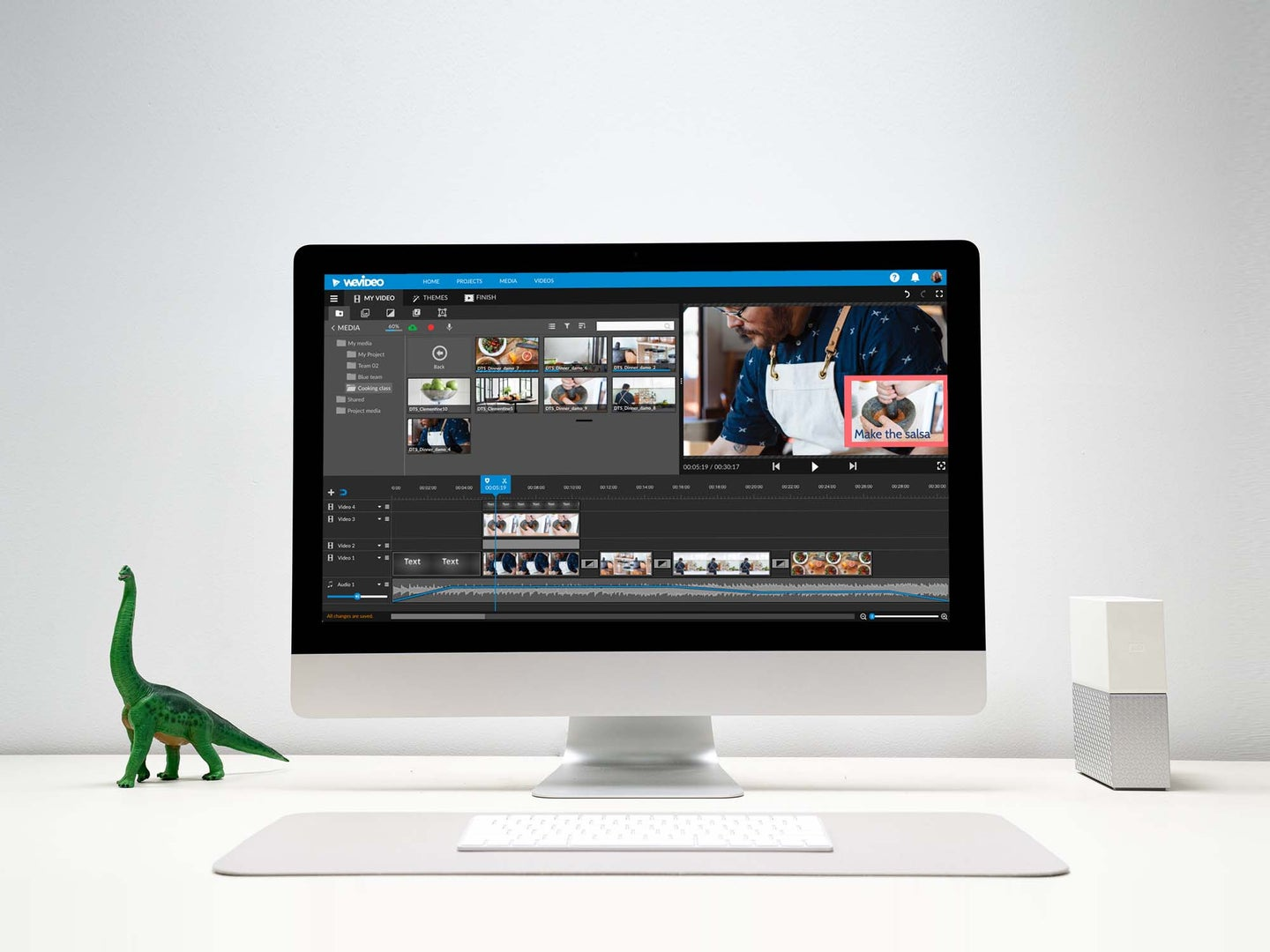 Computer on a white desk with WeVideo editing platform on the screen