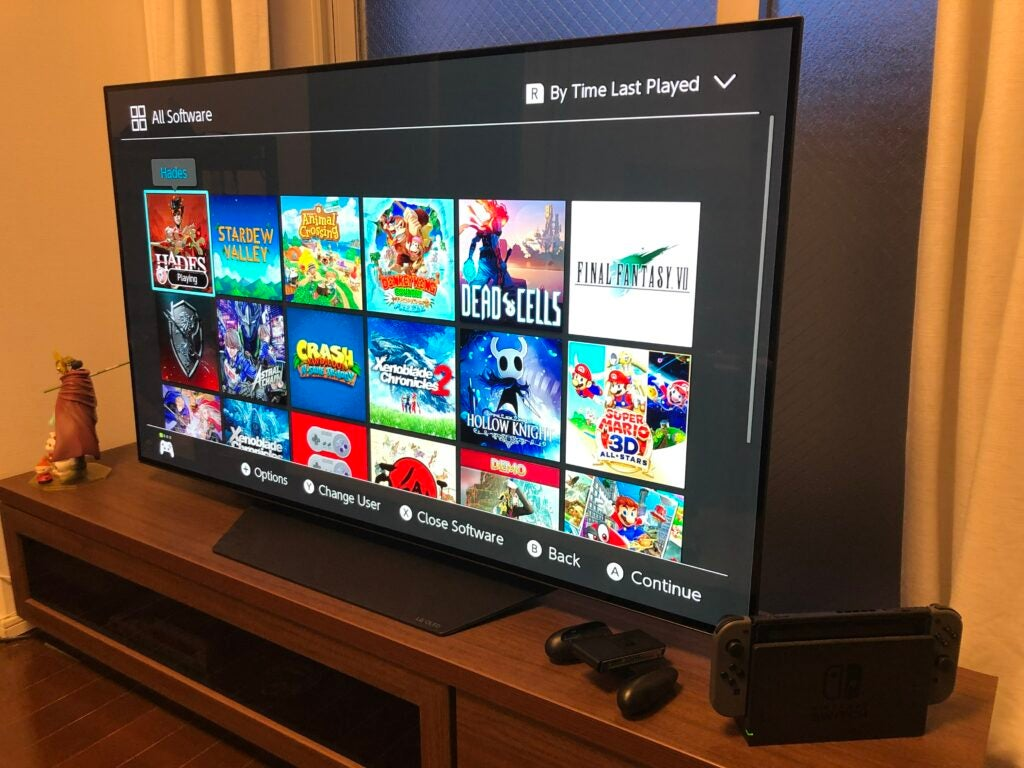 Nintendo Switch docked next to a flatscreen TV