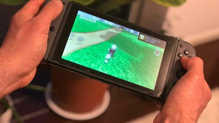Nintendo Switch handheld running Mario Odyssey