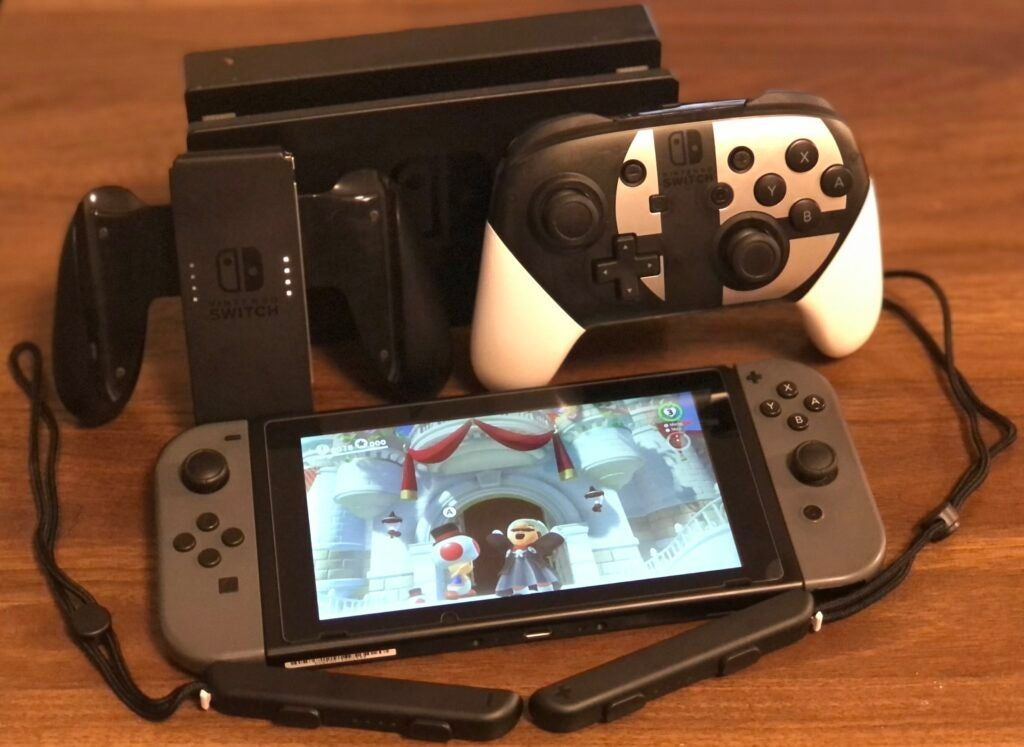 Nintendo Switch plus docking station and accessories