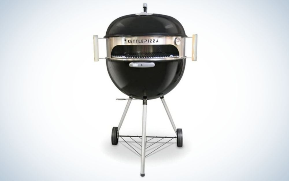 Black pizza oven kit with stainless sleeve, handles, thermometer, and aluminum pan