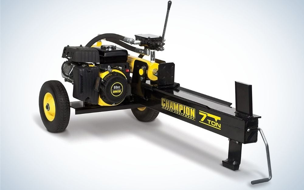 A horizontal gas log splitter with auto return with two black wheels and it all looks like a blacker yellow engine.
