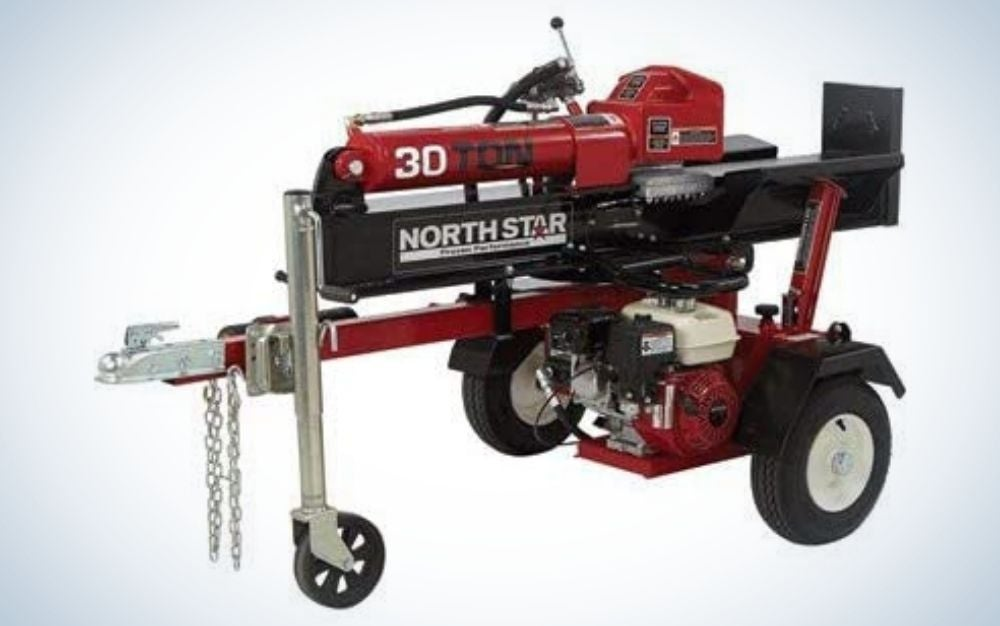 Acred and black vertical log splitter with two large wheels and one that is in the front of the engine.