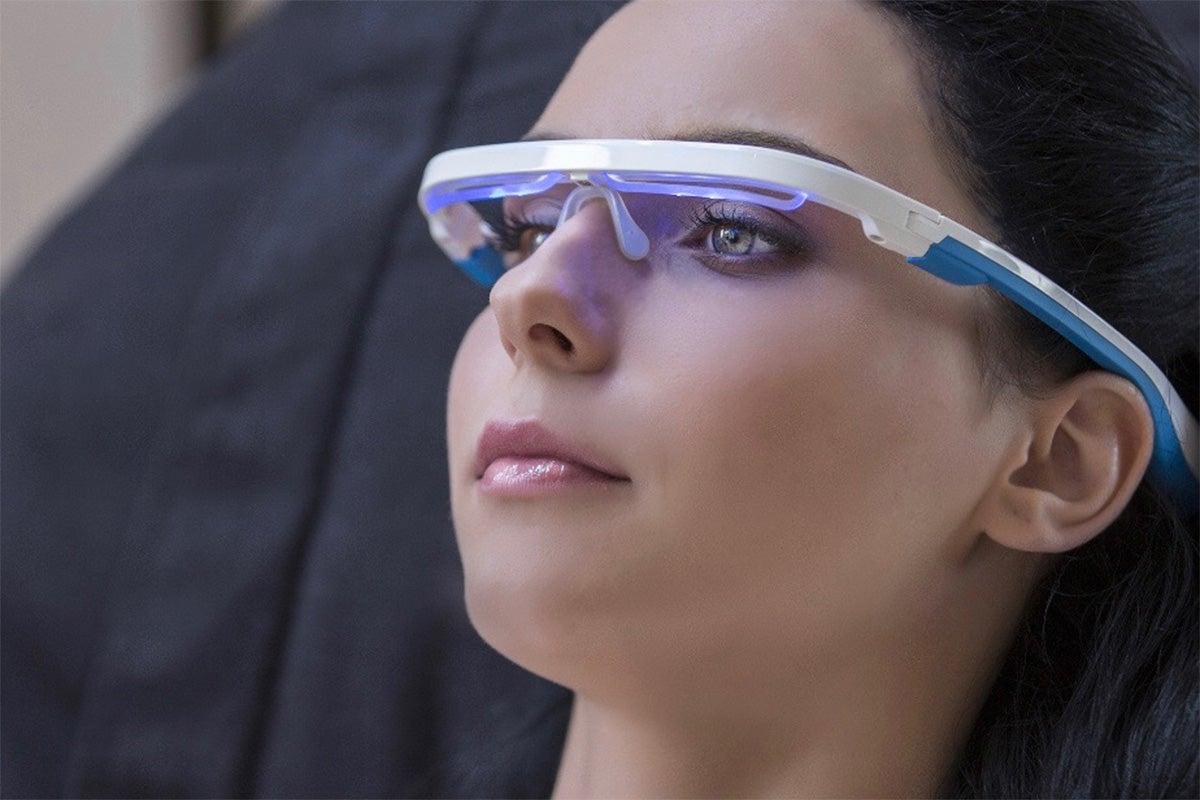 Woman wearing light technology glasses