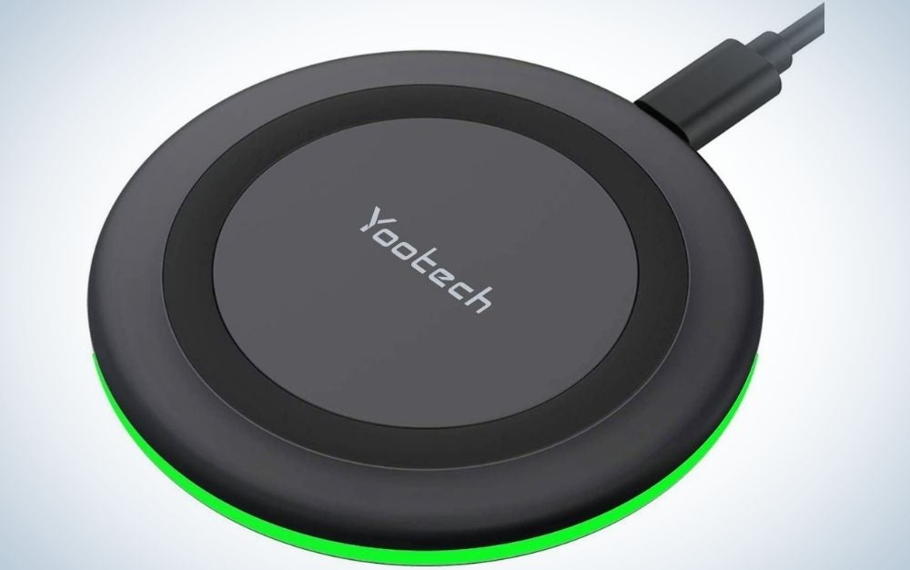 An all-black cordless charger with a circular shape and a life visa on the side.