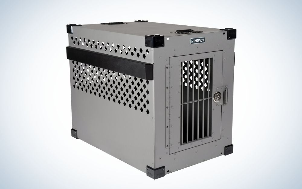 A metal dog cage with an entrance gate and the top of the cage with a few holes in it.