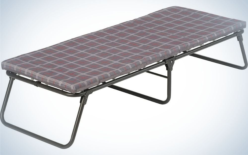 A portable layer with a layer like a thin blue mattress and leave with squares and three supporting legs.