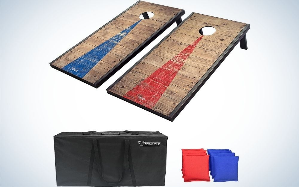 Two square wooden shapes with a blue and red stripe each of them and with a circular hole in their upper part, as well as a big black bag and some small square shapes red and blue in the shape of pillows.