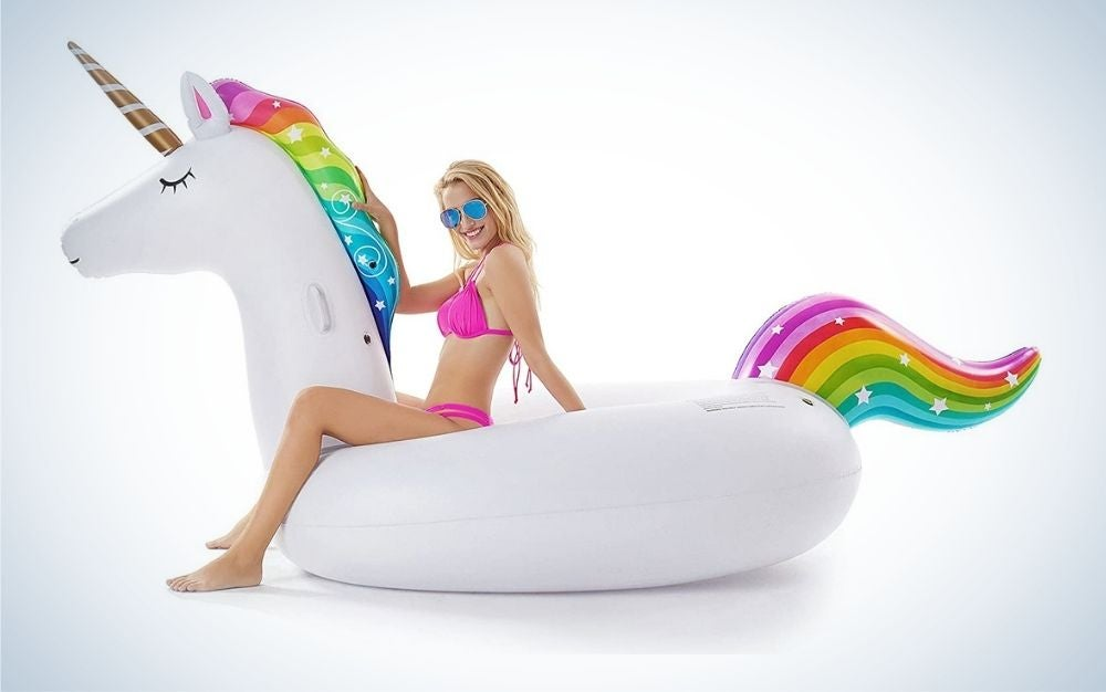 Girl sitting on a inflatable pool float