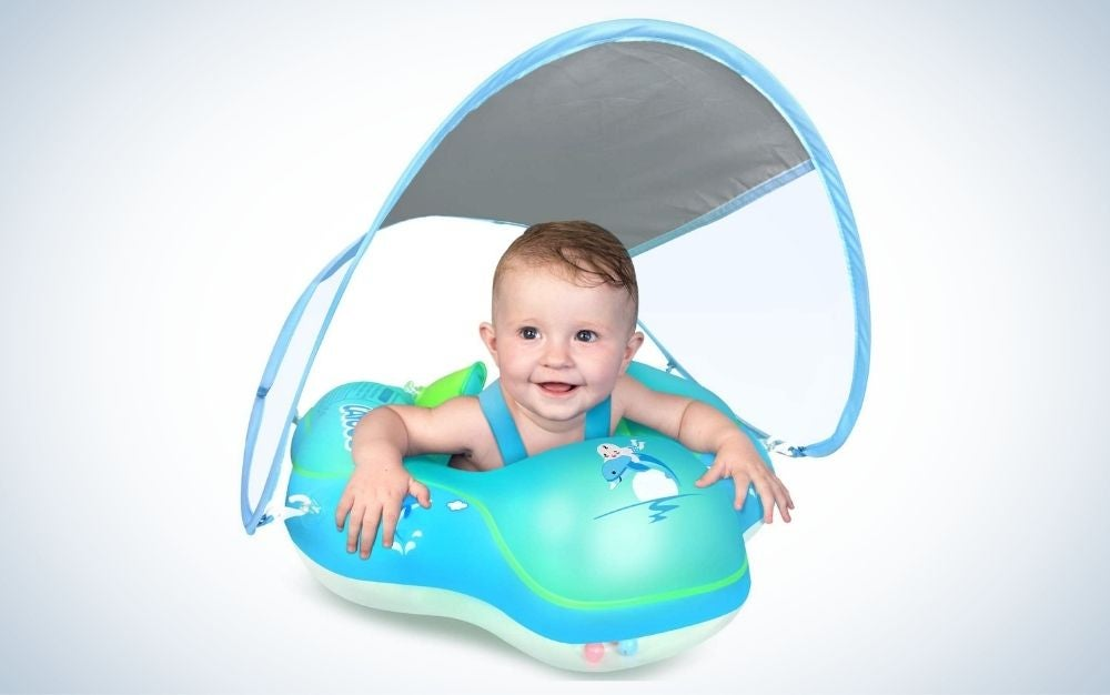 Baby a blue inflatable swimming pool float with sun protection canopy