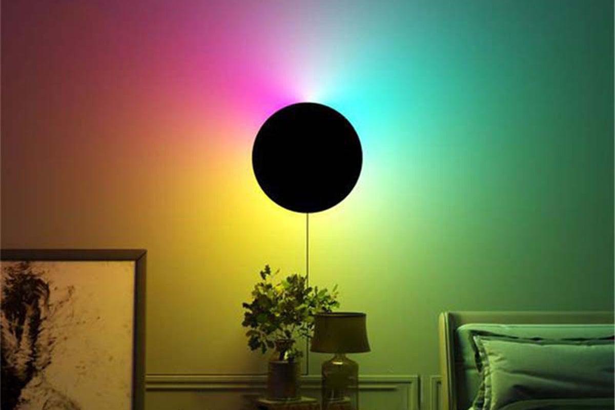 Lamp creating rainbow on wall