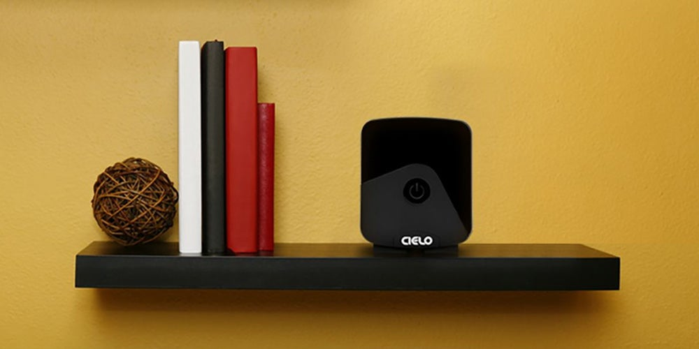 Shelf with books and home security system