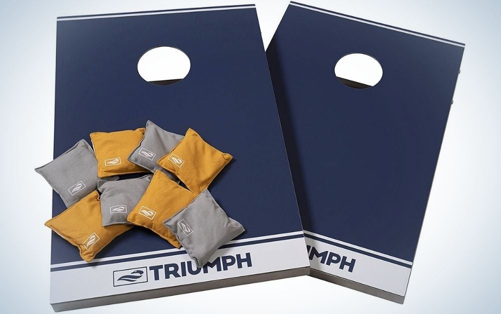 Two square wooden shapes with blur color on them and with the brand name written on them and some small square shapes of yellow and gray color in the form of pillows.
