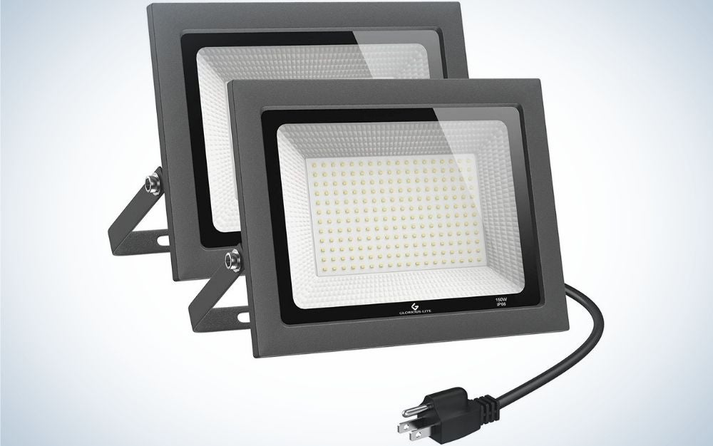 Two classic wall cameras with a black head and body in a square shape, as well as the front part made of transparent glass, and the two lamps with two black plugs in them.