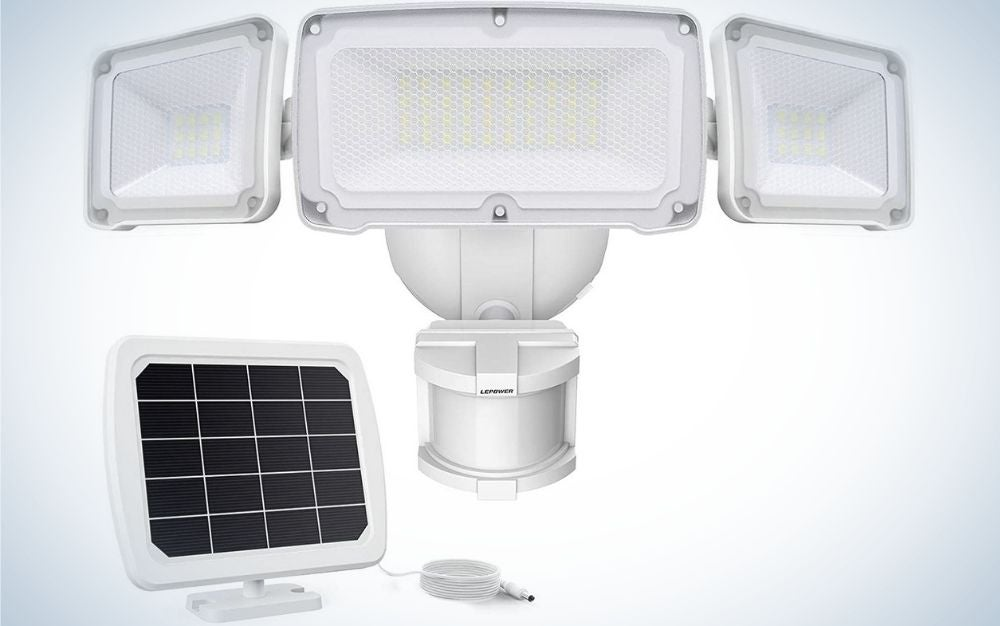 A white machine all that functions as a solar and receives light from the sun and is a light with sensor at night to protect the environment from suspicious movements.