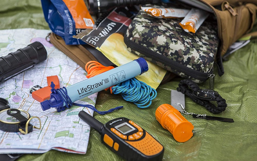 a lifestraw with other outdoor gear and camping gear