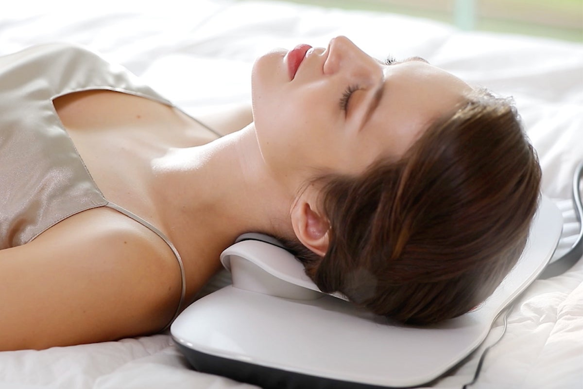 Woman laying with neck relaxation device
