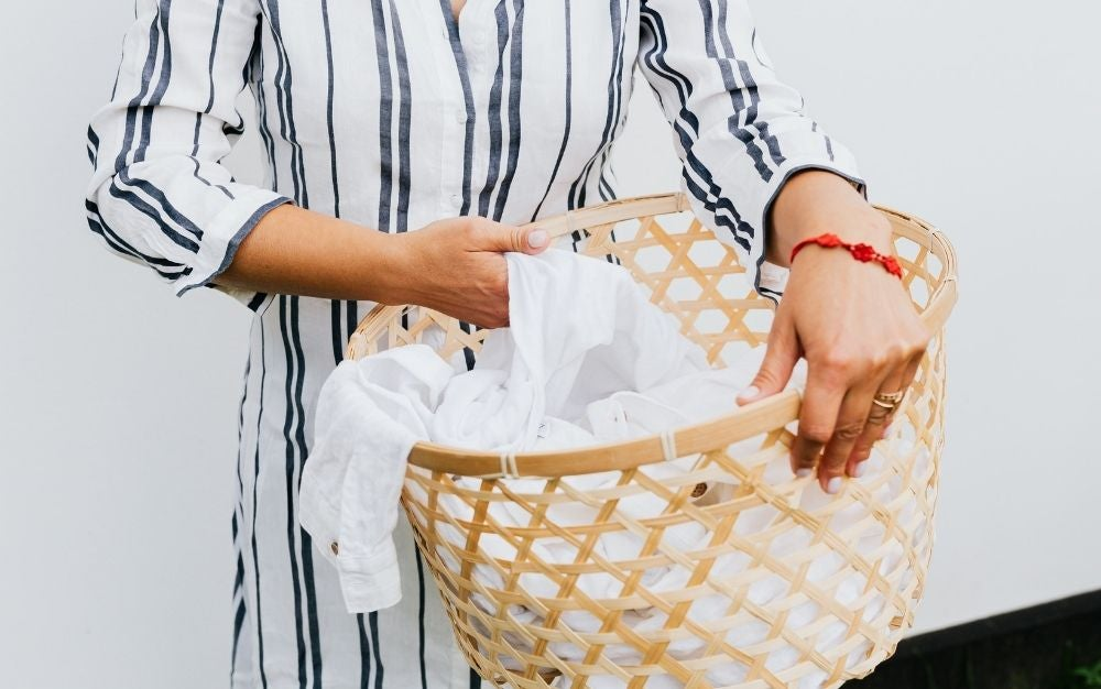 Women holding a laundry basket