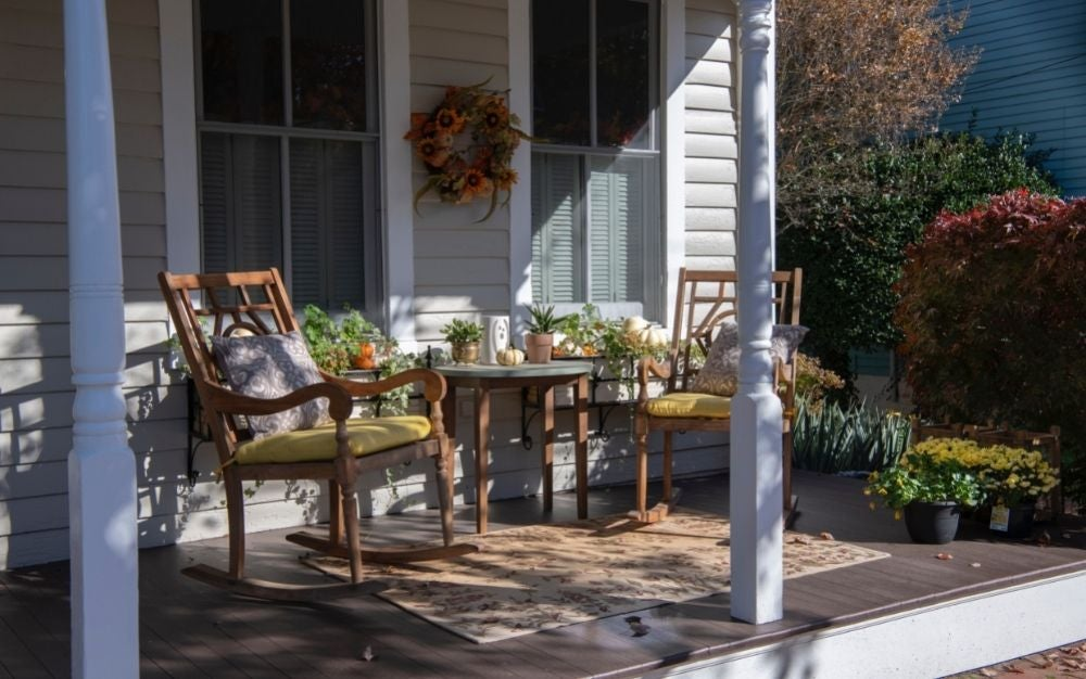 Patio chairs and a table on the porch.