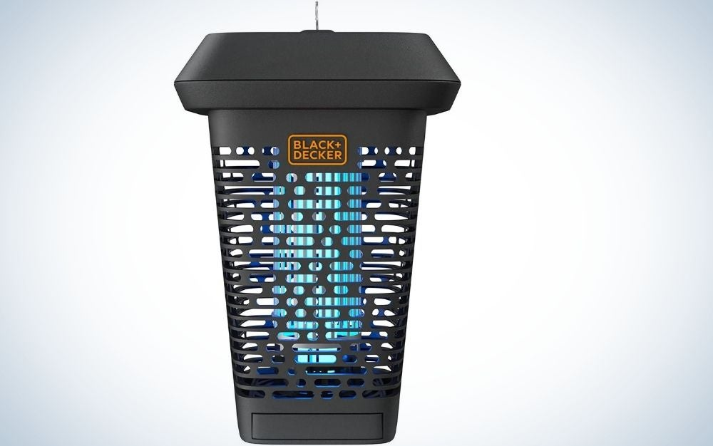 A bug zapper in the shape of a large glass which is black and has blue holes in it.