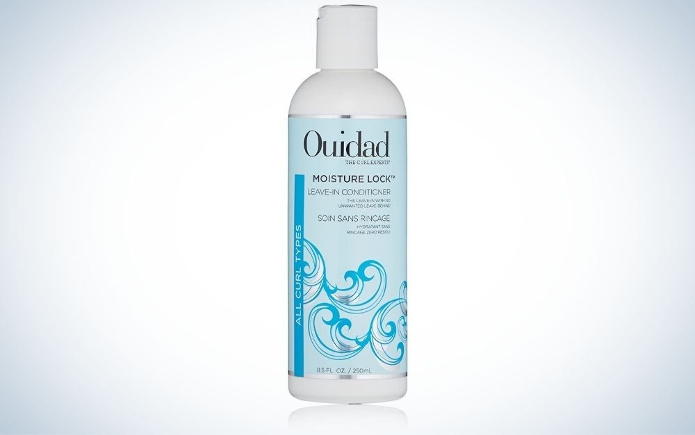 Bottle of ouidad leave-in conditioner for curly hair