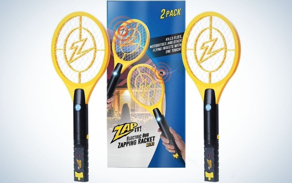 Two bug zapper rackets in yellow and a tail in black, as well as their packaging between two blue rockets and with rocket advertisements in them.