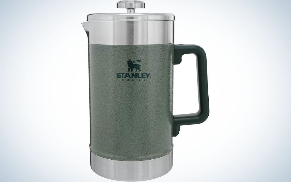 A kettle for storing the heat of coffee in it with a silver lid and a small holder, as well as a body of matte material of a gray color.