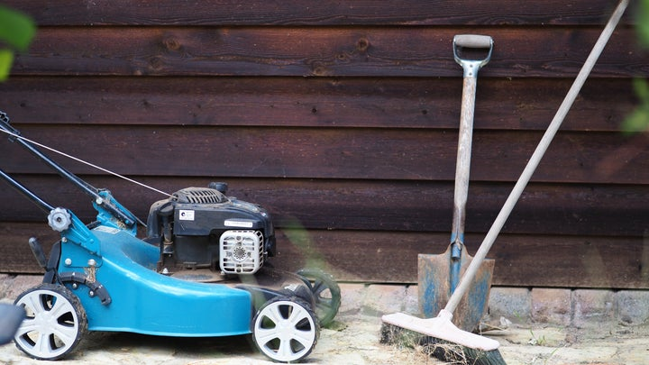A lawnmower, which you won't really need for a ground cover lawn, with a shovel and a broom for digging up your grass lawn.