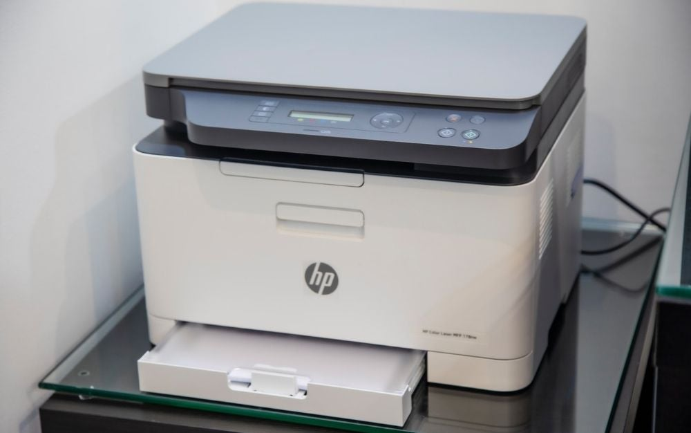 A large white square scanner with two parts like a classic scanner.