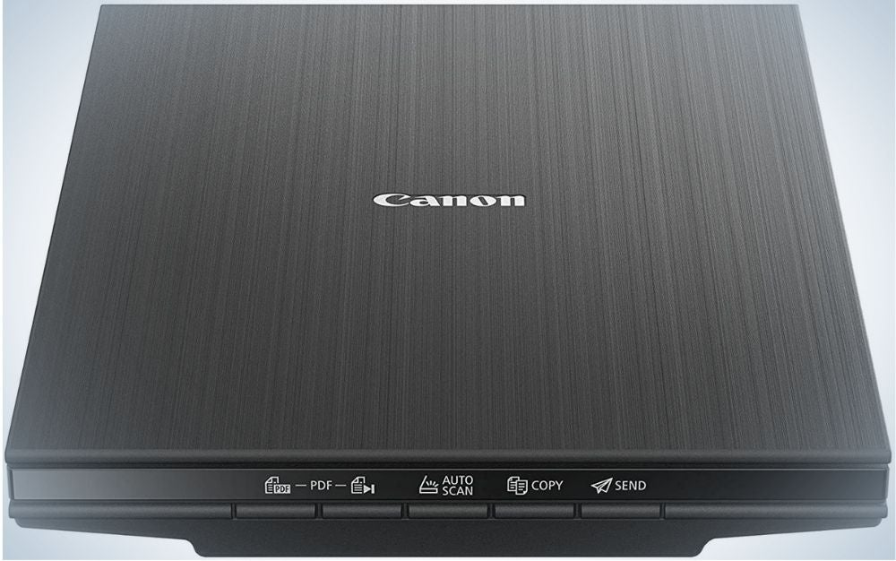A dark gray square laptop with the brand name on the top as well as some small notes and buttons on the back.