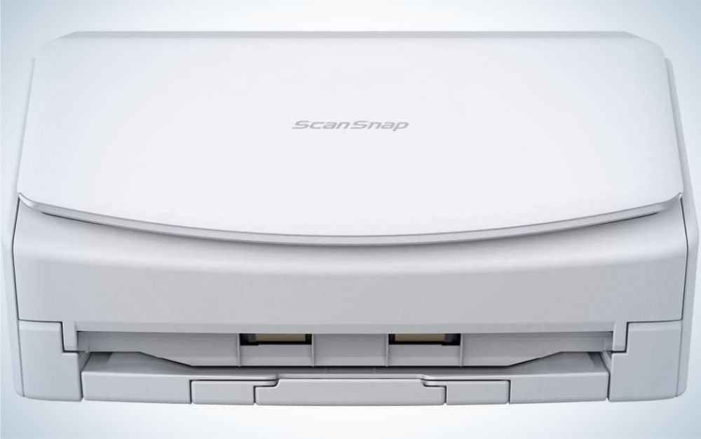 A large white and wide color scanner as well as with the brand name from above.