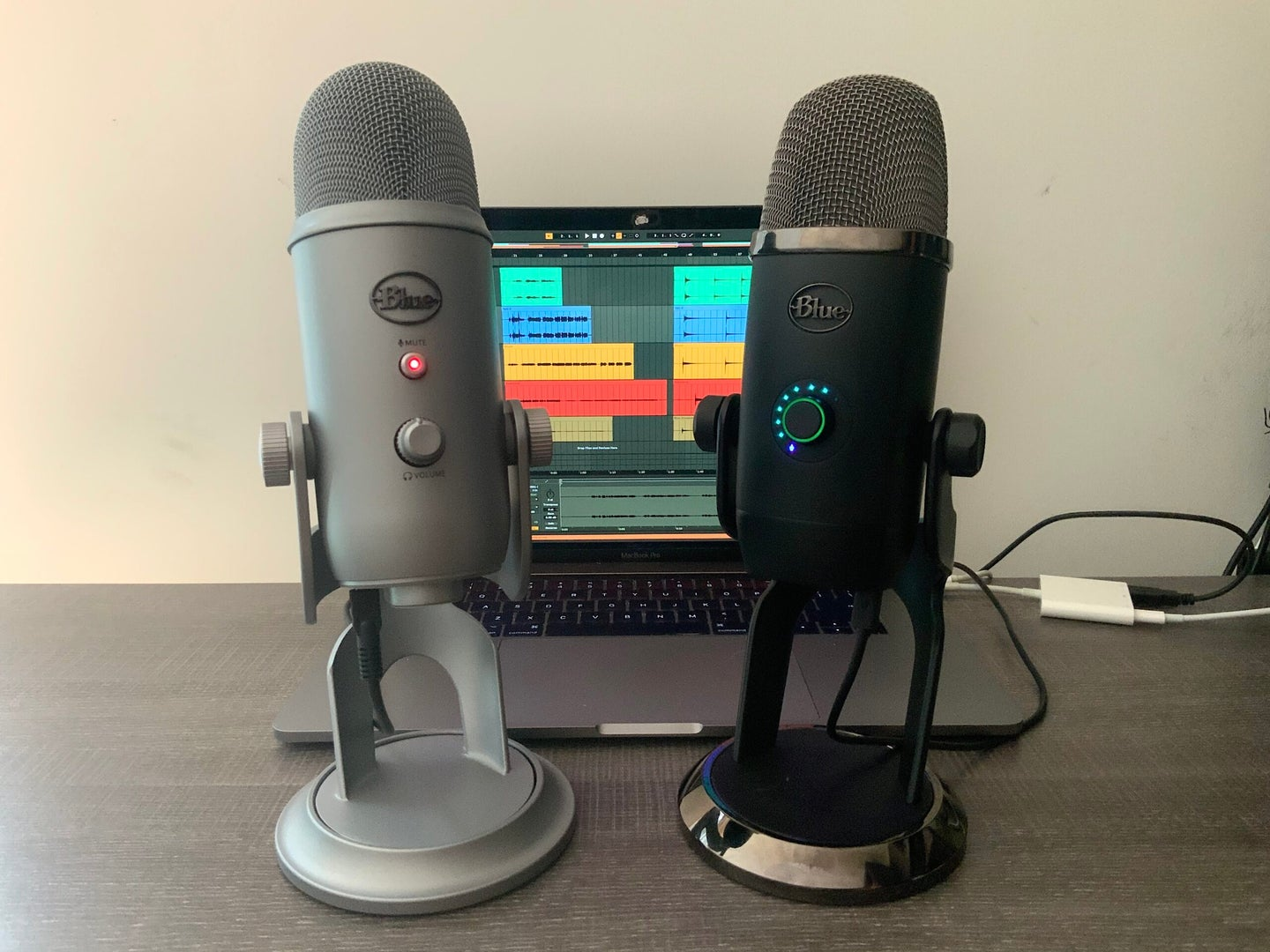 Blue Microphone Yeti and Yeti X in front of a computer